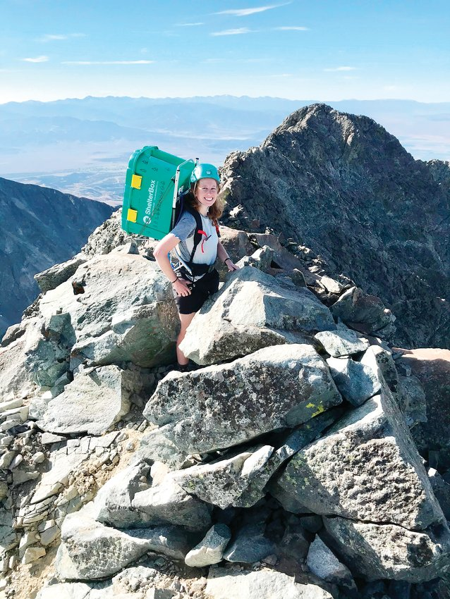 University of Denver graduate student Brittney Woodrum is pictured climbing Colorado's Little Bear Peak in the Sangre de Cristo Range. Through September, Woodrum will be climbing all 58 of Colorado's 14,000-foot mountains to benefit ShelterBox USA's COVID-19 Emergency Relief Fund.