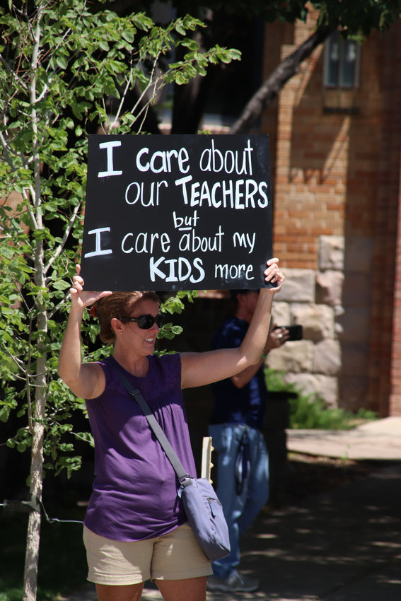 Parents protesting on July 31, 2020, to reopen schools said children's education will suffer to greatly if schools don't open for full, in-person learning.