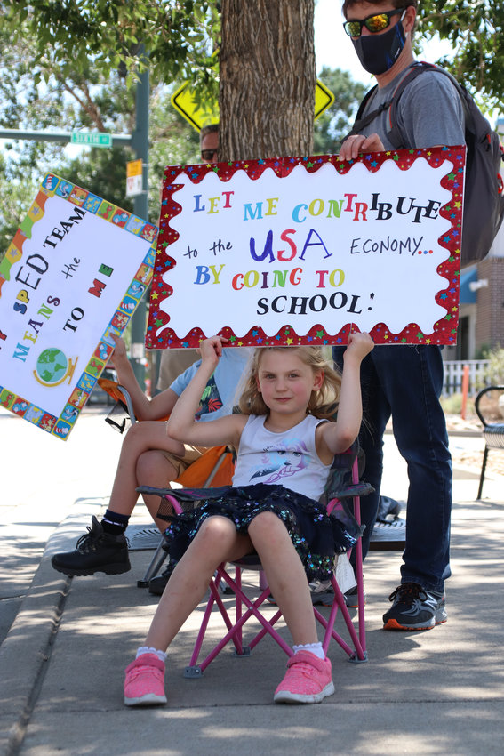 Serene Cline, 9, protests with her parents on July 31, 2020. The Cline family urged Douglas County School District to allow for 100% in-person learning.