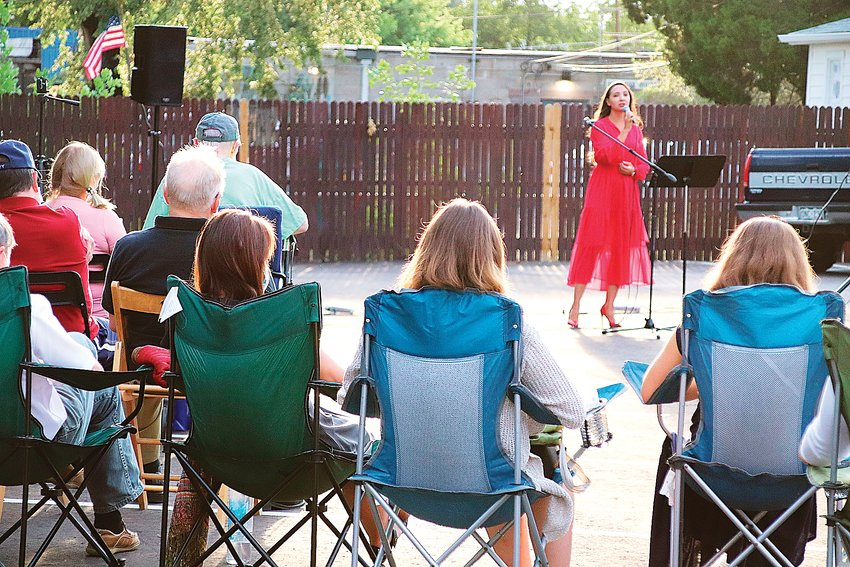 Renowned soloist Siuzanna Iglidan performs for her neighbors in a church parking lot in Englewood on Aug. 1.
