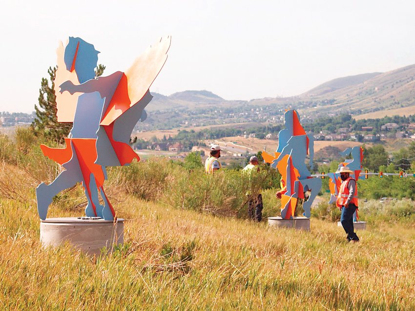 "Crews install Joe Norman's ""Run and Fly"" on the east side of Highway 93 north of Washington Avenue."
