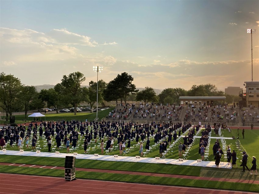 Graduates were spaced apart on the field at Jeffco Stadium during Columbine High School's graduation.
