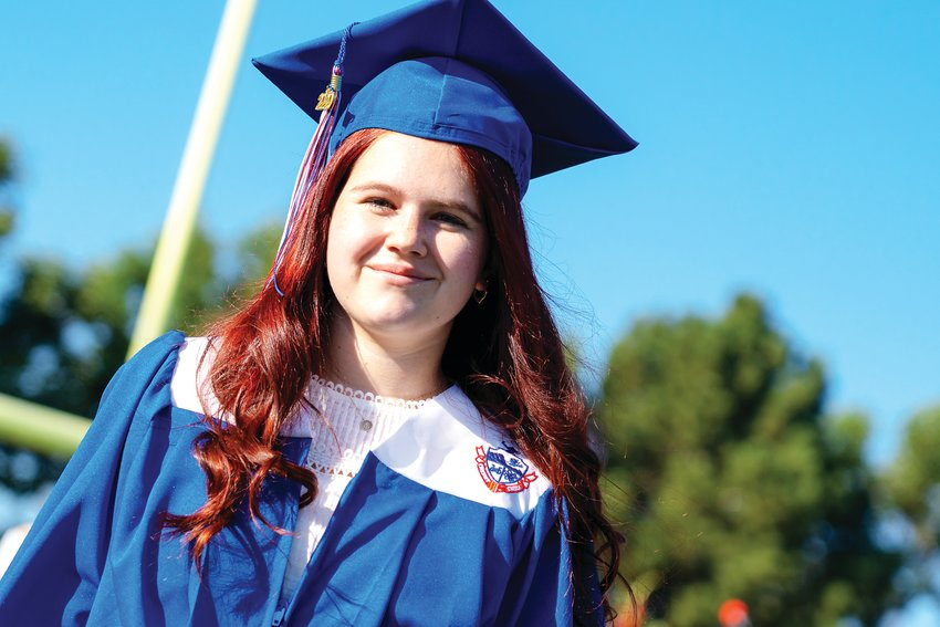 A student walks at Cherry Creek High School's graduation July 30.