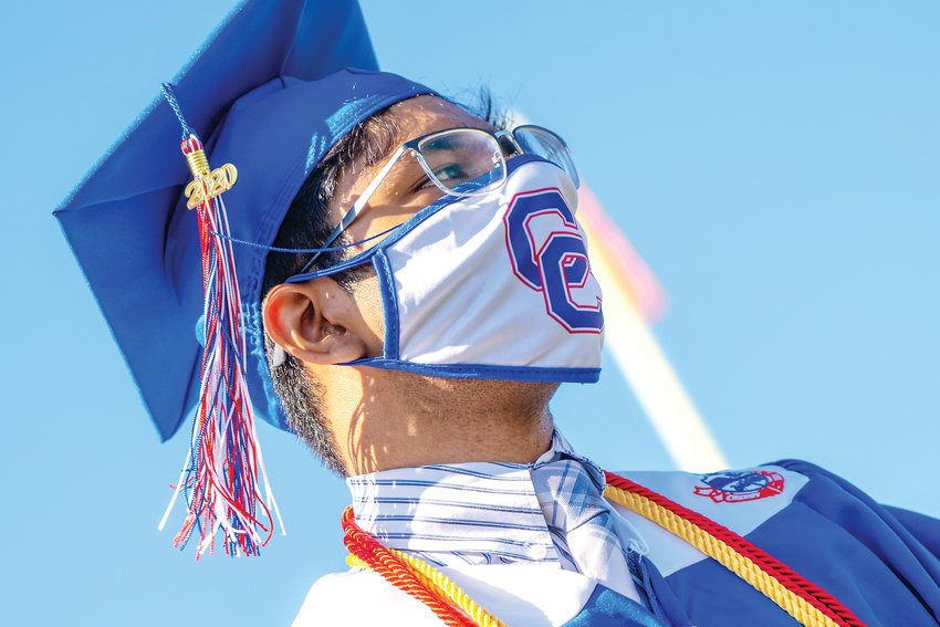 A student wears a mask July 30 at Cherry Creek High School's graduation. Students and guests were required to wear masks, and many of the graduates' masks bore their school's logo.
