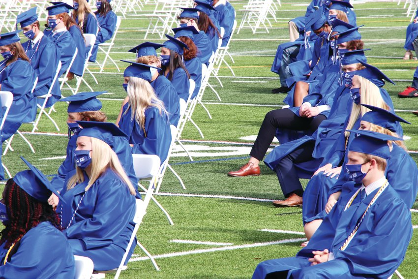 Students at Grandview High School's graduation ceremony sit in rows spaced apart to comply with social distancing guidelines amid the coronavirus pandemic.