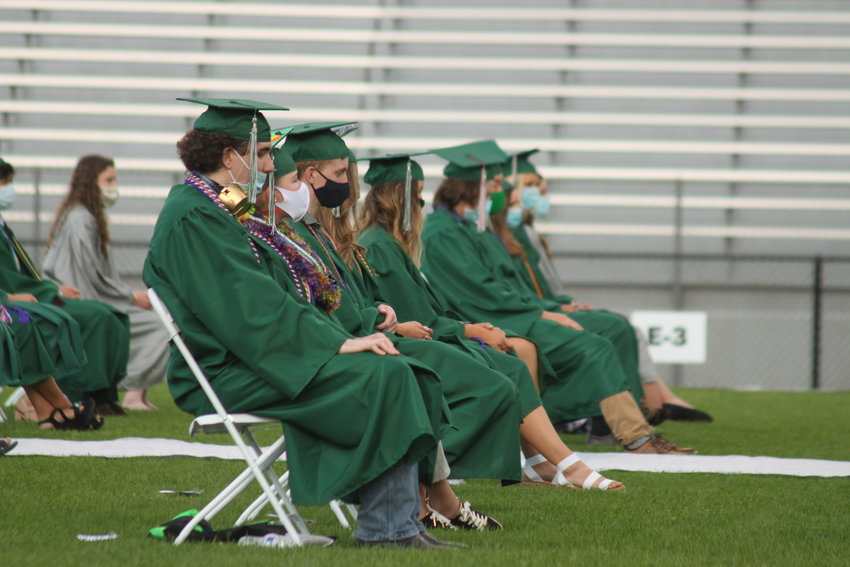 The Class of 2020 D'Evelyn graduates sat, spaced apart and wearing masks, on the field to commemorate their high school career.