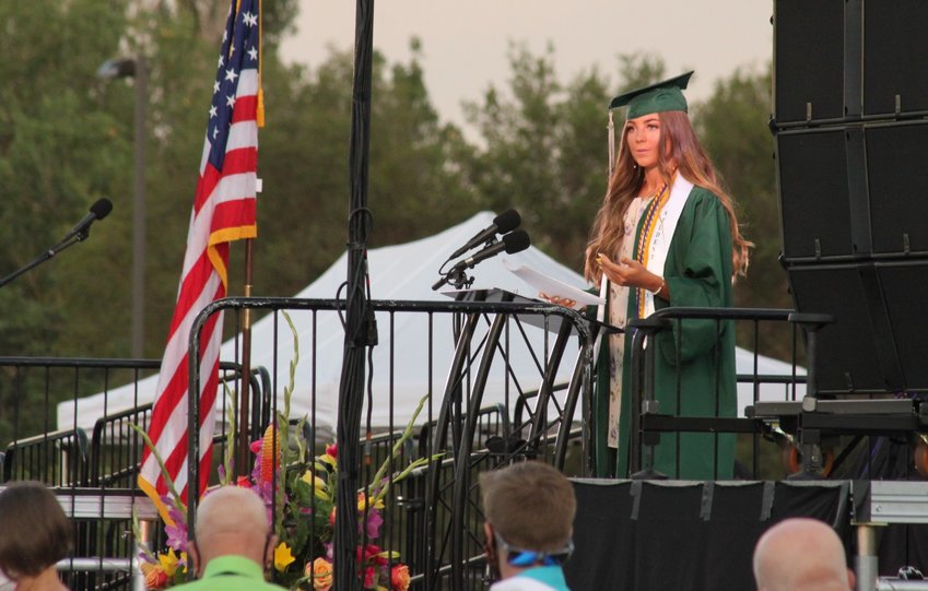 "Senior Class speaker Karsen Flom addresses the D'Evelyn Class of 2020. She recognized the members of the class going into the different branches of the military. ""For me,"" she said, ""Go Army."""