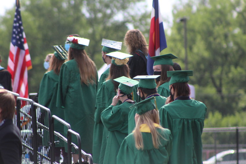 Bear Creek High School graduates make their way up to a stage to be recognized for graduating.