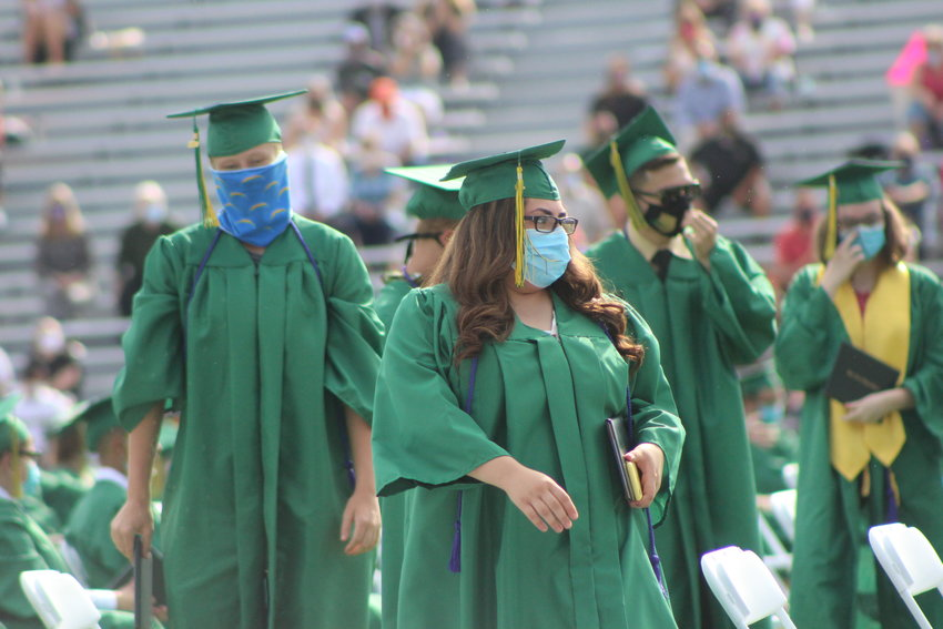 Three months after they finished school, Bear Creek High School 2020 graduates make their way up to a stage to be recognized on a hot August 8 morning.
