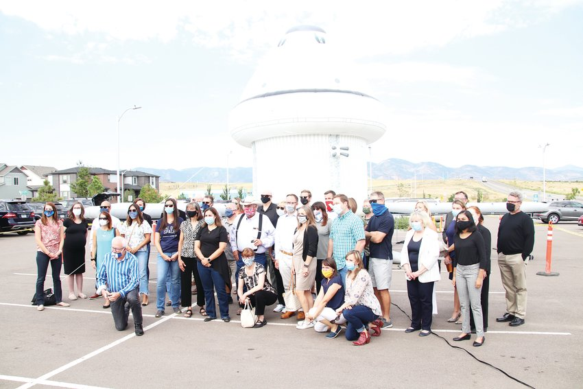 Legislators, lobbyists and business leaders pose for a picture in front of the inflatable Orion model August 6.