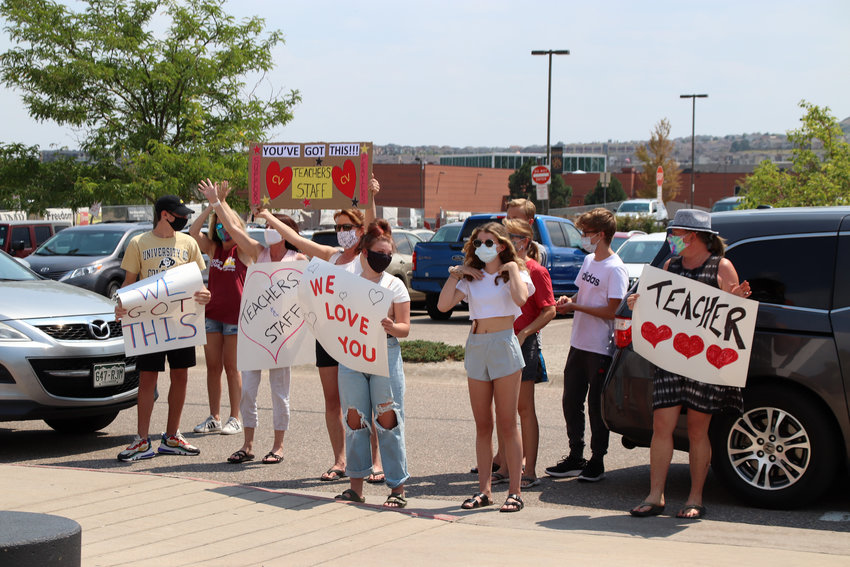 Community members cheered and honked for Douglas County school employees. Teachers returned to work on Aug. 4 as they prepare for students to start the year on Aug. 17.