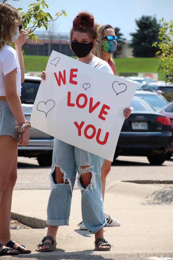 "Community members shouted ""thank you"" and ""we love you"" to educators as they rallied in support of Douglas County School District teachers and staff on Aug. 10."