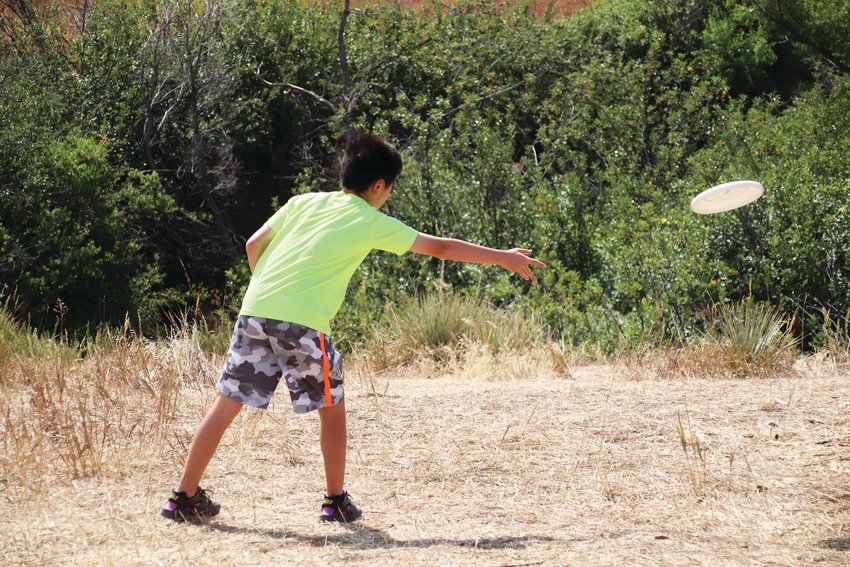 Skyler Lee, 13, tries out the new disc golf course in Highlands Ranch.