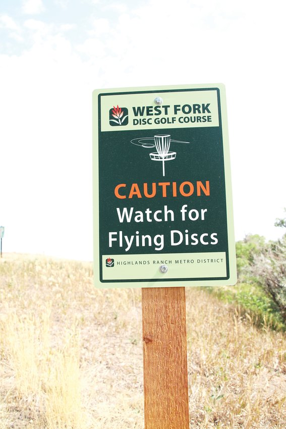 A sign at the West Fork Disc Course warns of flying discs.