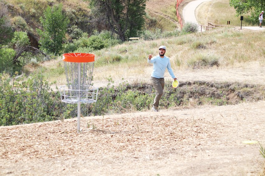 Eric Naegele throws a disc toward a hole at the new West Fork Disc Golf Course.