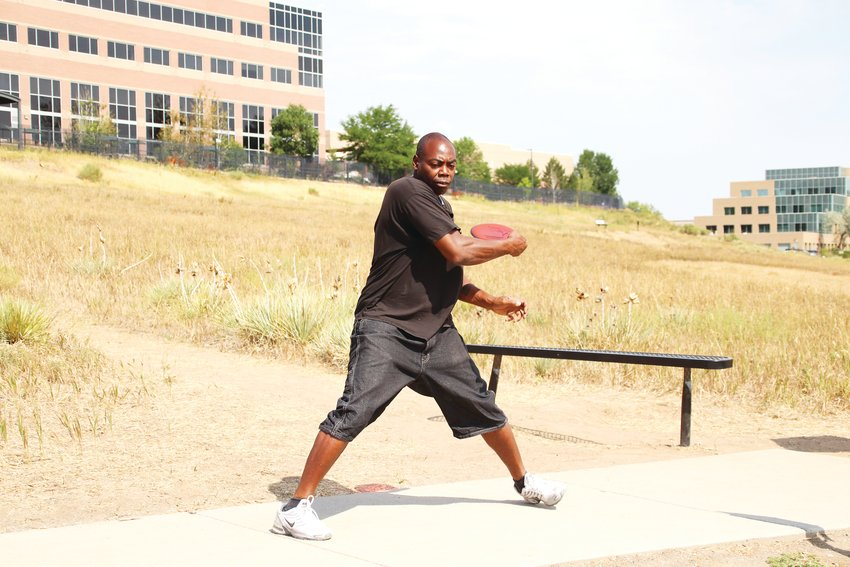 George Marion, a Denver area resident, throws a disc at the West Fork Disc Golf Course in Highlands Ranch.