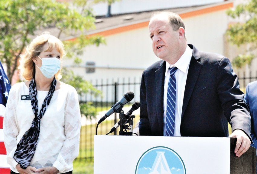 Governor Jared Polis makes a point Aug. 10 while Adams County Commissioner Eva Henry looks on. Polis opened two new free fast-track COVID-19 testing sites Aug. 10, one at the Aurora Sports Complex and a second at Water World in Federal Heights.