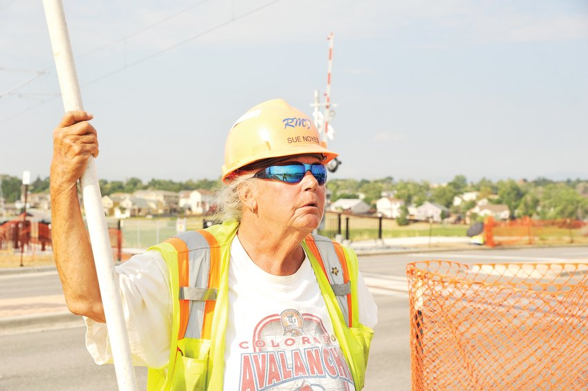 RTD Light Rail crossing guard Sue Noyes of Wheat Ridge works the N Line gate along Thornton Parkway on Thursday, Aug 6.