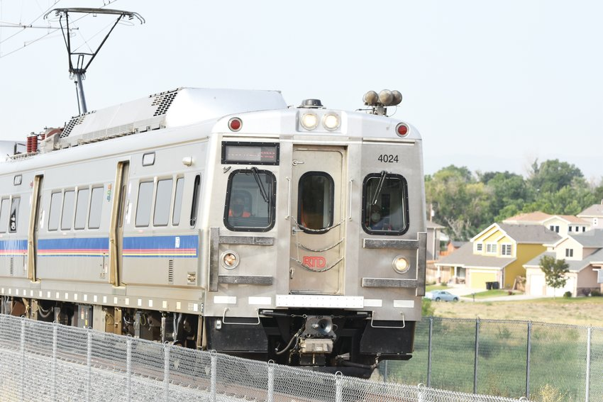 An RTD N Line train travels through a portion of old Thornton near Thornton Parkway, on August 6.
