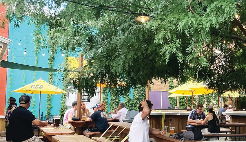 People drink on the patio of Golden City Brewery on Aug. 7. Although many restaurants are starting to recover from the pandemic, others are still struggling, particularly those that lack a patio.
