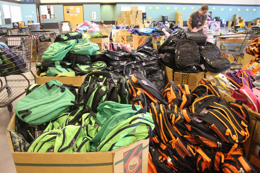 Some of the backpacks the Action Center prepared to donate. The Action Center estimates that it served at least 4,000 Jefferson County students through its school supply distribution event this year.