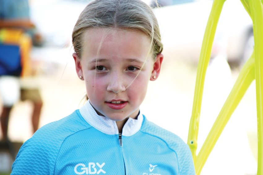 Taya Tousley, 10, stands at her father's tent at the Colorado Junior Cup after placing second in her age bracket earlier that day.