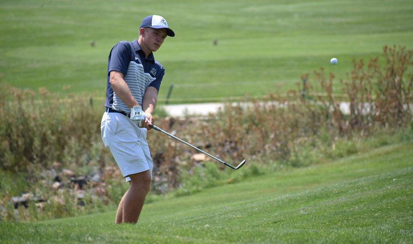 Columbine senior Drex Duffy watches his chip up to the green during the second Jeffco League boys golf tournament of the season Monday, Aug. 17, at Raccoon Creek Golf Course in Littleton. Duffy shot a round of 76.