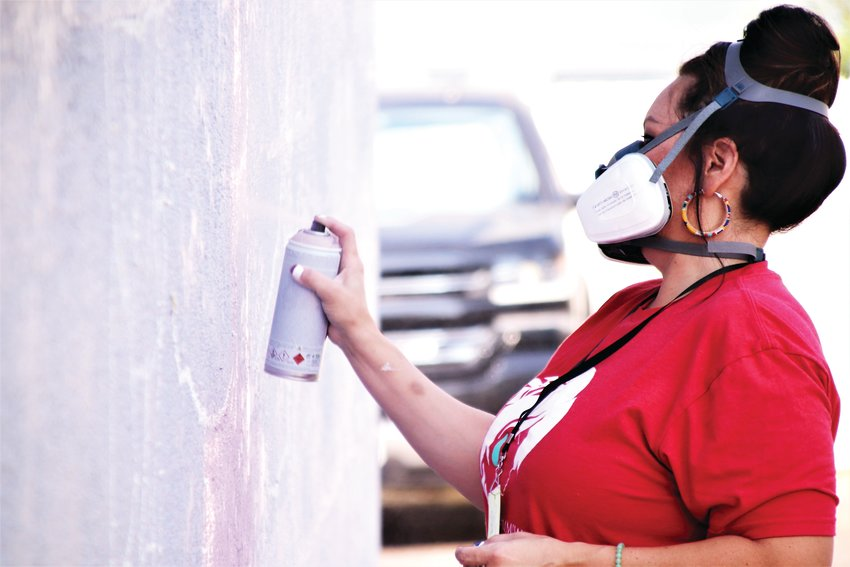 Danielle SeeWalker begins painting her mural on the wall of 7181 Hooker St. Aug. 13. She's one of 28 artists in Westminster decorating walls as a part of the Babe Walls festival, an effort to bring women artists to the decorate buildings in Westminster.
