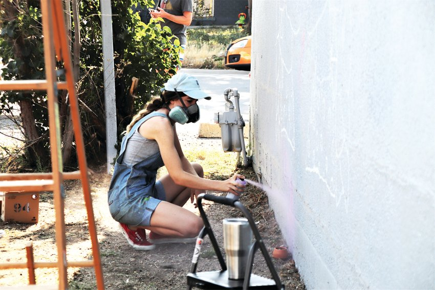 Artist Romelle begins painting the northern wall of the building at 7181 Hooker St. in Westminster Aug. 13. She's one of 28 artists coming to the city for the Babe Walls festival.