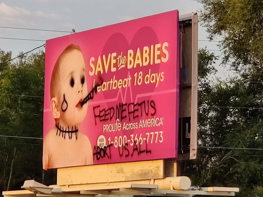 The pro-life billboard on South Golden Road, which was vandalized days earlier. The billboard was taken down, but then the blank space was also spraypainted.