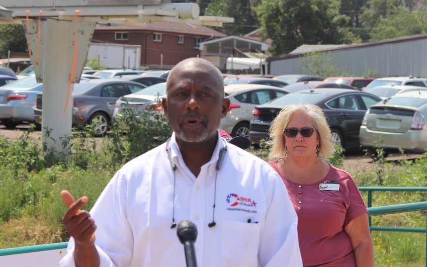 Republican CD7 candidate Casper Stockham discusses the billboard. Laurel Imer stands behind him.