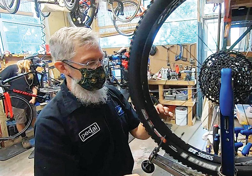 Pedal bike shop in Littleton has seen business surge during the pandemic.