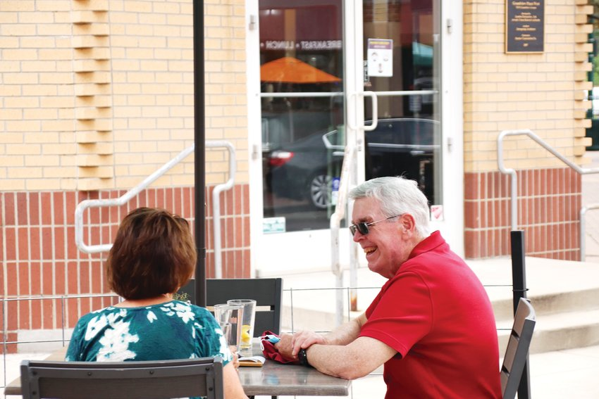 Customers enjoy an afternoon meal on the expanded patio of Smokin' Fins.
