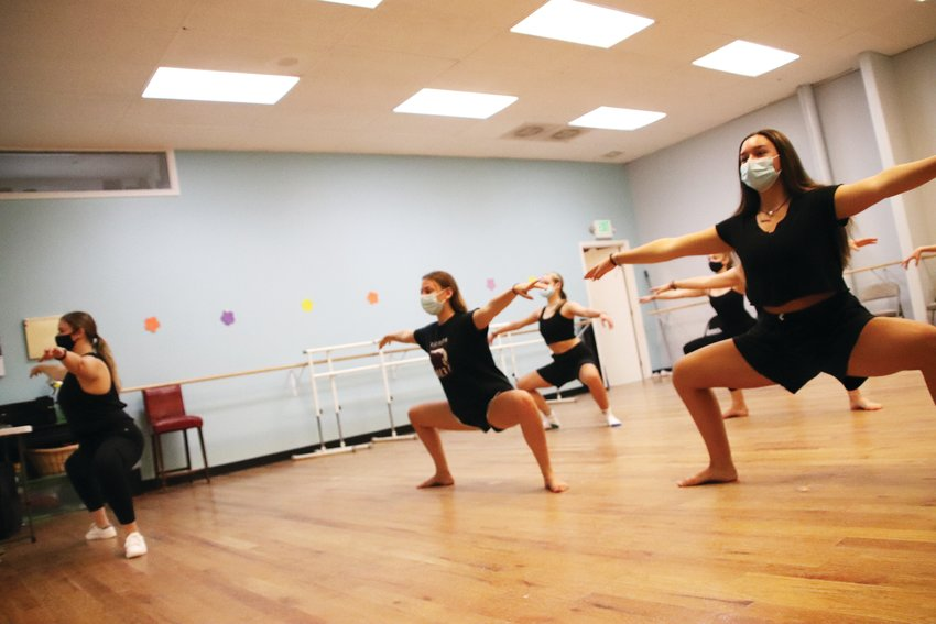 Students at the Parker Dance Academy do plie squats led by Studio Director Lexie Steinhaus. Some students say their strength has improved over the months because they have been forced to relearn some of the basics from home.
