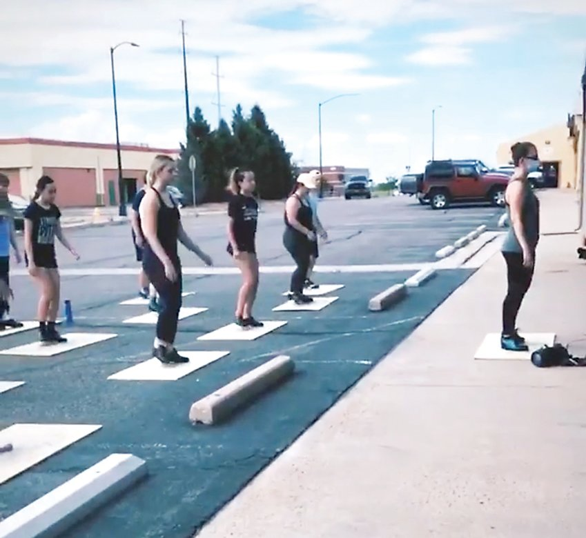 Students at the Parker Dance Academy take part in an outdoor lesson in a parking lot near the studio. Dancers and teachers are adjusting to virtual and socially distanced learning, creating unique obstacles and opportunities.