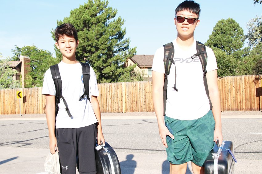 Alex Ford, left, and Isaac Kwon walk to Smoky Hill High School near the Aurora-Centennial border on Aug. 18, their first day of school as freshmen.