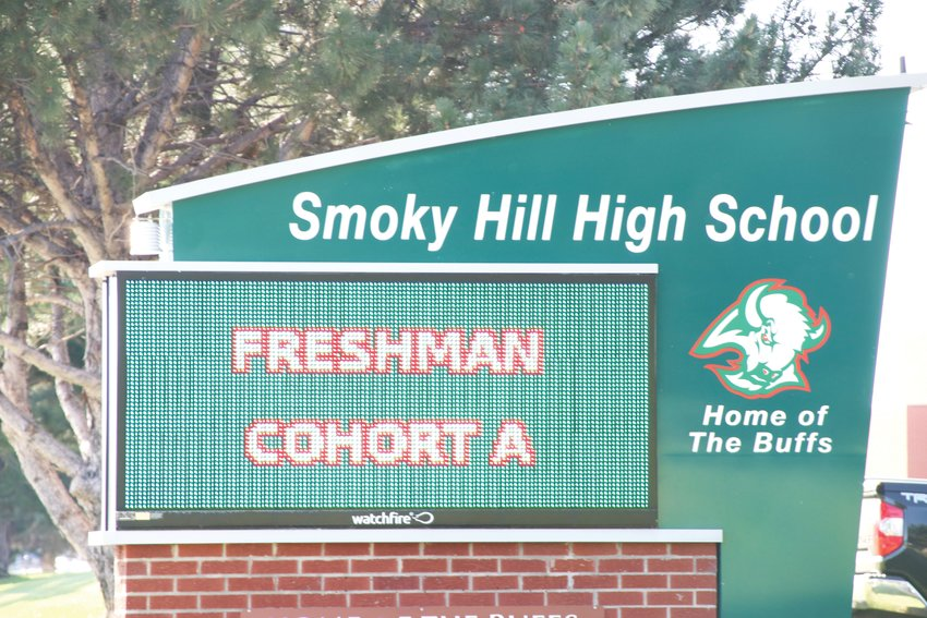 "The electronic sign outside Smoky Hill High School in the east Centennial area Aug. 18 displays the phrase ""freshman cohort A."" Middle- and high-schoolers in Cherry Creek School District are assigned to ""A day"" or ""B day"" groups, based on their last name, to lessen the number of students attending school on any given day and support social distancing."