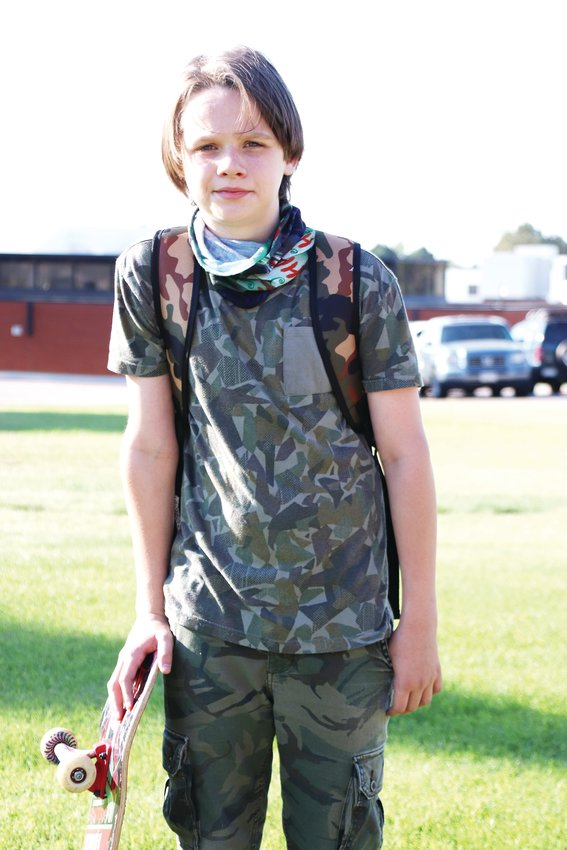 "Nathen Ball, a seventh-grader, on his walk to Laredo Middle School. Different grades returned to school on different days the week of Aug. 17, which was organized as a ""phase-in week"" in which students could come to school to practice new routines, and staff and students could begin to develop relationships, prior to the full start of school."