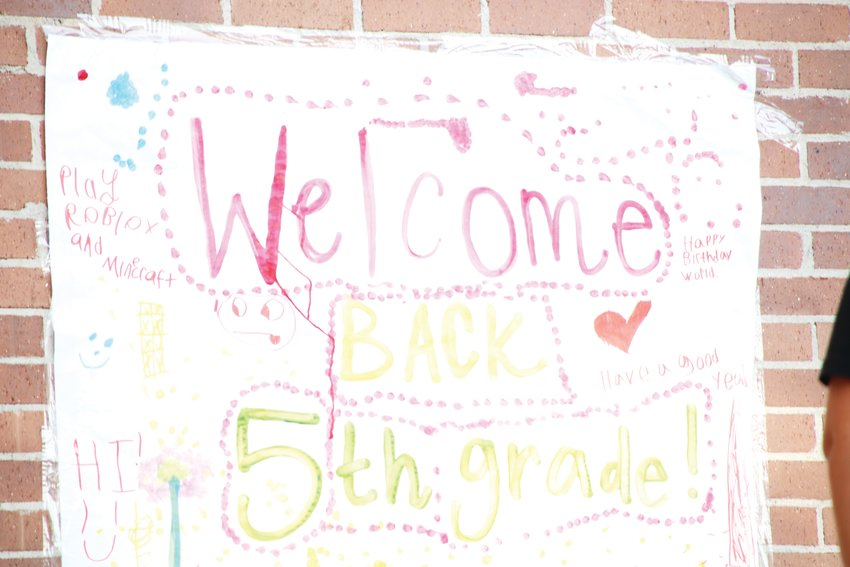 "A colorful sign says, ""Welcome back 5th grade!"" on the wall on the outside Walnut Hills Elementary School Aug. 17 in west Centennial."