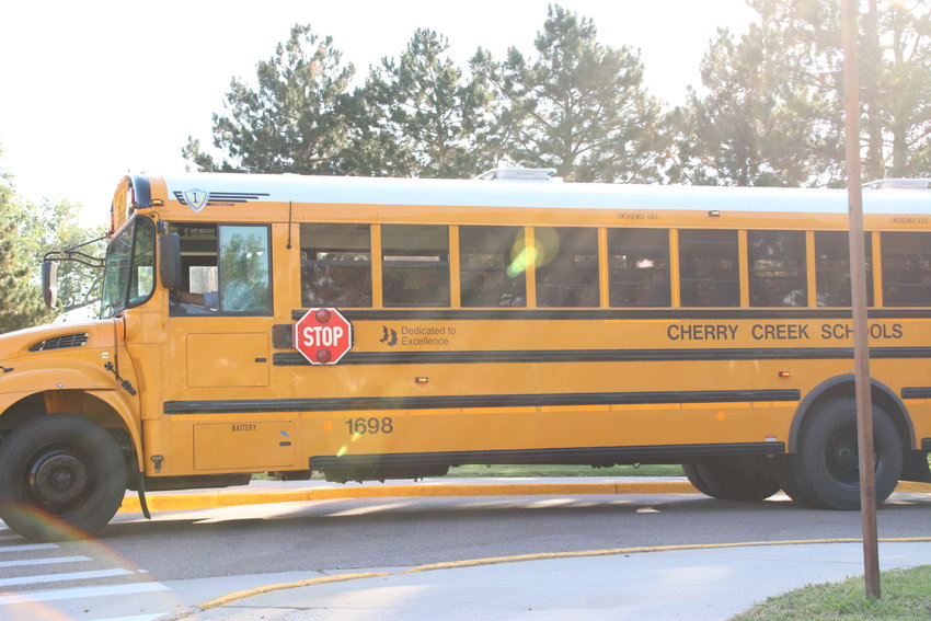 A bus pulls out of Smoky Hill High School's parking lot on Aug. 18, the first day of school for freshmen in Cherry Creek School District.