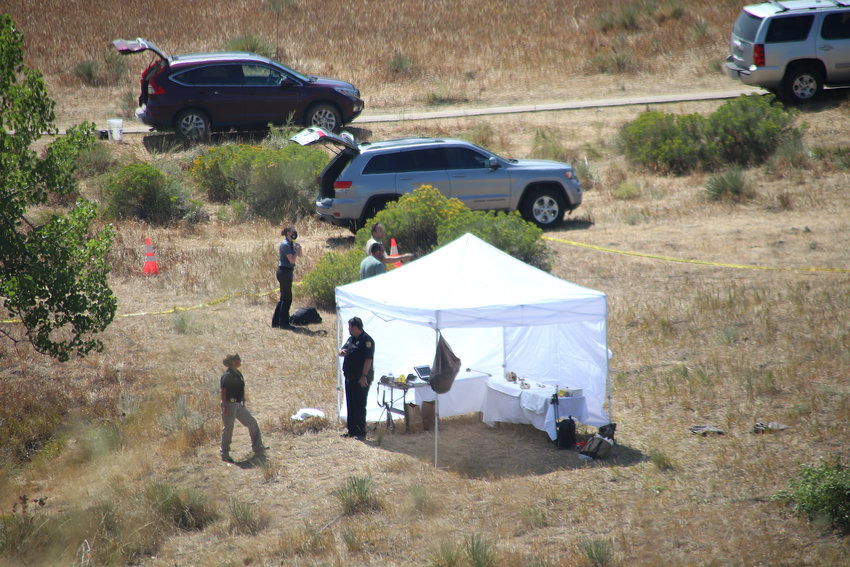 Douglas County Sheriff's Office personnel investigate the scene at West Fork Disc Golf Course in Highlands Ranch Thursday, Aug. 27.