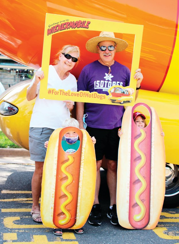 Barb and Mike Mulkey of Denver's West Highlands neighborhood get their picture taken with their grandchildren, Ted, 3, and Grace, 4, in front of the Oscar Mayer Wienermobile at the Denver Zoo on Aug. 19.