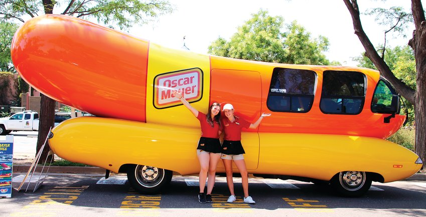 Oscar Mayer Hotdoggers Relish Rachel Aul and Ketchup Katie Ferguson stand in front of the iconic Wienermobile during its visit to the Denver Zoo on Aug. 19.