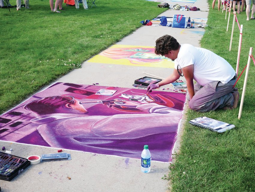 A chalk artist creates a piece of art for a previous year's Wheat Ridge RidgeFest. Despite the pandemic, this year's RidgeFest will take place Sept. 11 through Sept. 13. The free event will feature live music, the chalk art festival, a classic car show and more.