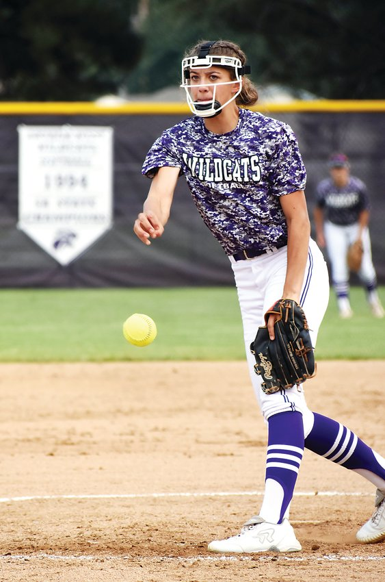 Arvada West freshman Mackenzie Ferguson fires to the plate during the Wildcats' game against Conifer on Aug. 24.