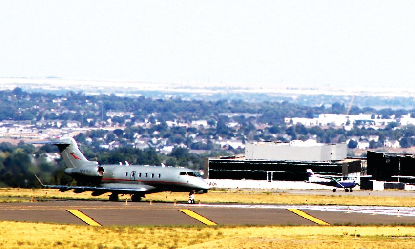 A private jet taxis in after landing at the Rocky Mountain Municipal Airport Sept. 2. The airport was one of several front range airports that received federal grants for work. In Rocky Mountain's case, the money will pay for long-awaited repairs to the airport's taxiway.