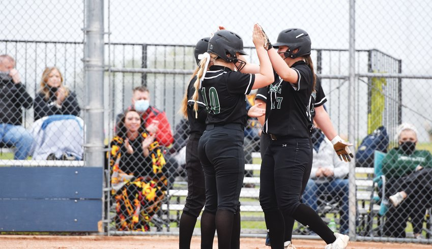 Fossil Ridge's Katelyn Hays, right, is greeted by her teammates after hitting a 2-run homer in the top of the 4th inning against Legacy Sept. 10 in Broomfield. The blast put Fossil Ridge ahead 6-0 en route to a 12-2 win over the Lightning.