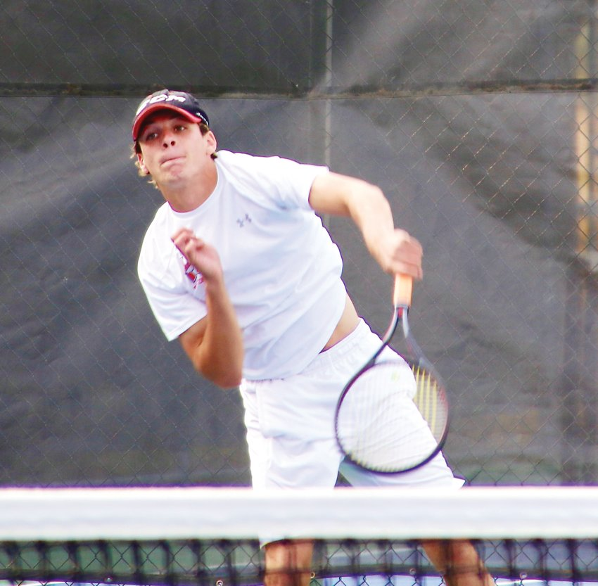 Heritage senior Jackson Scott returns a volley during the Region 5 boys tennis finals which were held Sept. 17 at Heritage High School. Scott defeated Boulder's Nathaniel Spillmann, 6-2, 6-4, to win the regional championship.