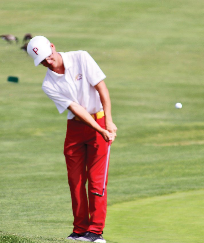 Ponderosa's Johnny Williams chips towards the 18th green on Sept. 15 during the final Continental League boys golf tournament of the season. Williams shot a 1-over-par 73.