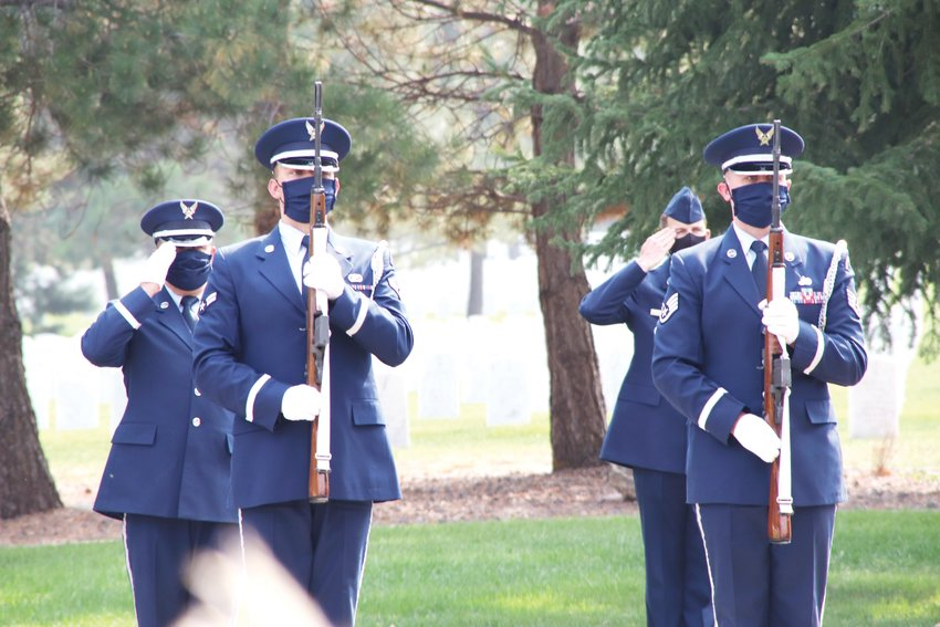 Military personnel at Fort Logan National Cemetery salute during the Sept. 18 memorial service for Tom Munds. Munds, who died Feb. 6 at 82 after a battle with cancer, spent 21 years in the Air Force and went on to cover Englewood as a news reporter for decades. Current and former Englewood city officials attended his service.